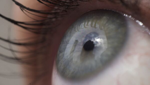 This April 12, 2018 file photo shows the eye of a woman in New York.   Patients are about to be enrolled in the first study to test gene editing inside the body to try to cure an inherited form of blindness. People with the disease have healthy eyes but lack a gene that converts light into signals to the brain that enable sight - Sputnik International