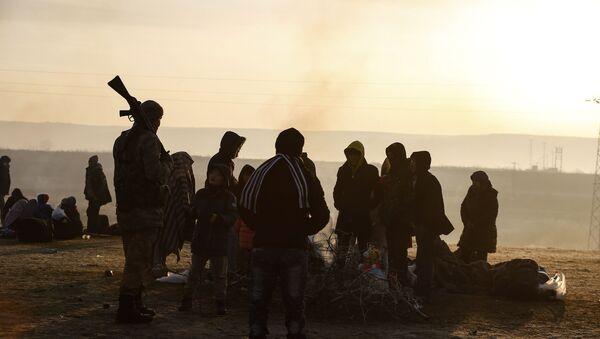 Migrants gather at Maritsa river (Evros river in Greek) as a boy speaks with a Turkish soldier near the Pazarkule border gate in Edirne, Turkey, Sunday, March 1, 2020 - Sputnik International