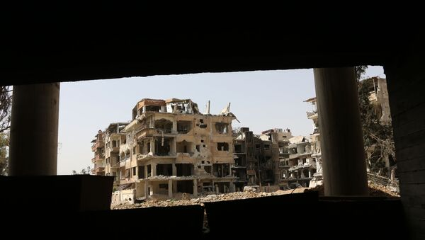 A general view shows destroyed buildings in the former rebel-held Syrian town of Douma on the outskirts of Damascus on April 19, 2018 - Sputnik International