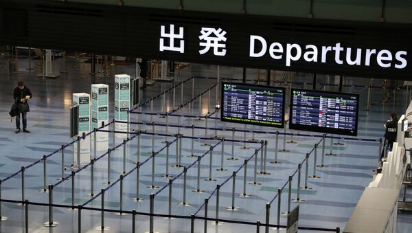 An empty departures gate is pictured at Haneda Airport in Tokyo, Japan, 4 March 2020. - Sputnik International