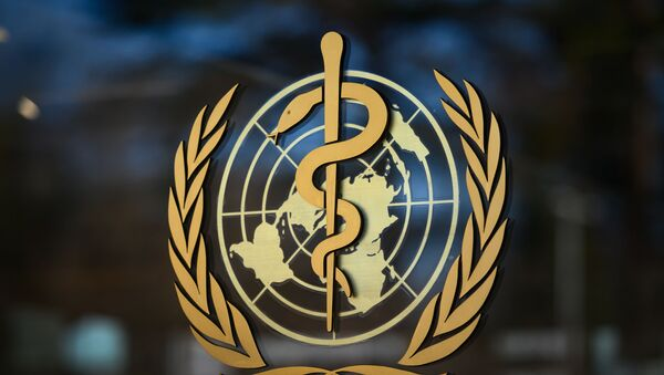 A photo taken on 24 February 2020 shows the logo of the World Health Organization (WHO) at their headquarters in Geneva. - Fears of a global coronavirus pandemic deepened on Monday as new deaths and infections in Europe, the Middle East and Asia triggered more drastic efforts to stop people travelling. - Sputnik International