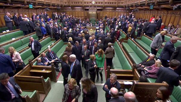 FILE PHOTO: MPs leave the House of Commons to vote in the election of the new Speaker of the House, in London, Britain November 4, 2019, in this screen grab taken from video. Parliament TV via REUTERS./File Photo - Sputnik International