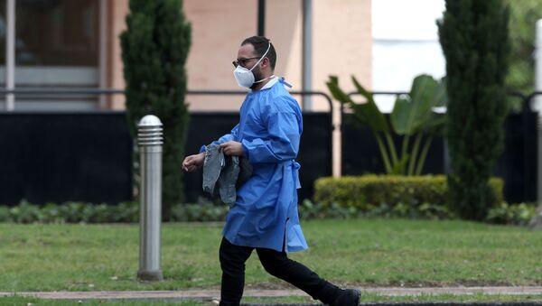 A man wearing face mask walks outside a sports centre in Bogota, Colombia February 28, 2020 - Sputnik International