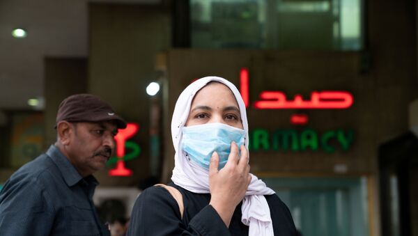 A woman wears a protective face mask, following the outbreak of the new coronavirus, in Kuwait, February 25, 2020 - Sputnik International