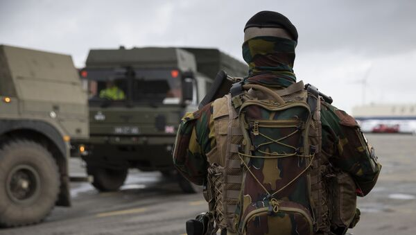 A Belgian solider patrols in a temporary military zone as vehicles arrive from a British naval vessel, taking part in U.S.-led war games, at the Port of Antwerp in Antwerp, Belgium, Monday Feb. 3, 2020. The Defender-Europe 2020 exercises will involve approximately 20,000 American troops; the biggest deployment of U.S.-based soldiers to Europe in 25 years. - Sputnik International