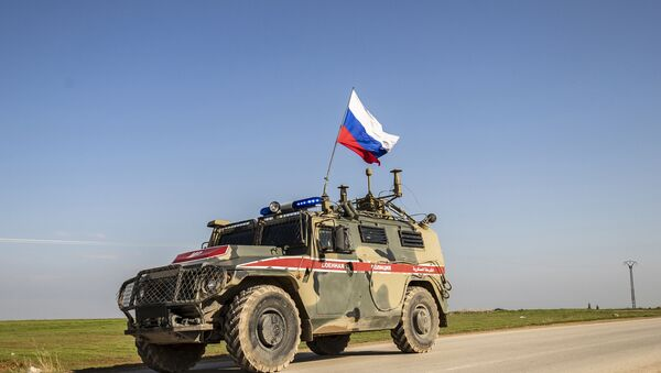A Russian military police vehicle in the town of Darbasiyah in Syria's northeastern Hasakeh province along the Syria-Turkey border - Sputnik International