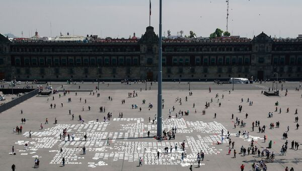 Women paint names of femicide victims during International Women's Day at Zocalo square, in Mexico City, Mexico March 8, 2020 - Sputnik International