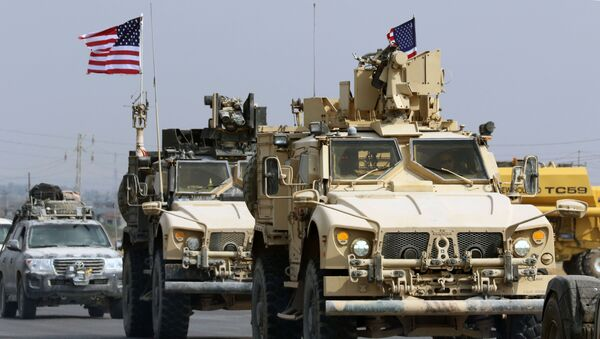 A convoy of US military vehicles arrives near the Iraqi Kurdish town of Bardarash in the  Dohuk governorate after withdrawing from northern Syria on October 21, 2019.  - Sputnik International