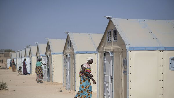 In this photo taken on Tuesday, Dec. 10, 2019 displaced Burkinabe people in the Pissila town camp, near Kaya, Burkina Faso. Islamic extremists carried out a record number of attacks last year in Burkina Faso and the instability has now spread to the country's east. The violence in northern and now eastern Burkina Faso has displaced more than half a million people, according to the United Nations. And there are fears the unrest could throw elections planned for late 2020 into question. - Sputnik International