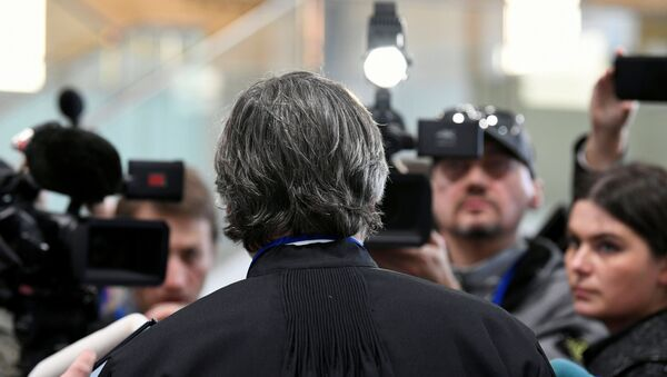 Peter Langstraat, lawyer representing victims' families, talks to the media after a Dutch court opened the criminal trial against four suspects in the July 2014 downing of Malaysia Airlines flight MH17, in Badhoevedorp, Netherlands March 9, 2020. REUTERS/Piroschka Van De Wouw - Sputnik International