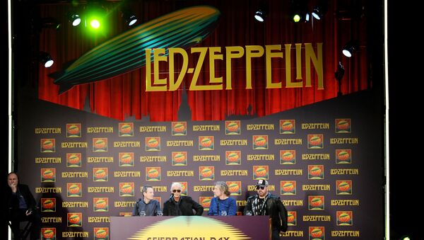 Led Zeppelin, from left, bassist/keyboardist John Paul Jones, guitarist Jimmy Page, singer Robert Plant, and drummer Jason Bonham participate in a press conference ahead of the worldwide theatrical release of Celebration Day, a concert film of their 2007 London O2 arena reunion show, at the Museum of Modern Art on Tuesday, Oct. 9, 2012 in New York. - Sputnik International