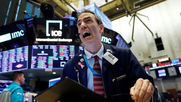 A trader works on the floor at the New York Stock Exchange (NYSE) - Sputnik International