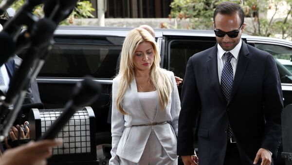 Former Donald Trump presidential campaign foreign policy adviser George Papadopoulos, right, who pleaded guilty to one count of making false statements to the FBI during the agency's Russia probe, holds hands with his wife Simona Mangiante, as they arrive at federal court for sentencing, Friday, Sept. 7, 2018, in Washington. - Sputnik International
