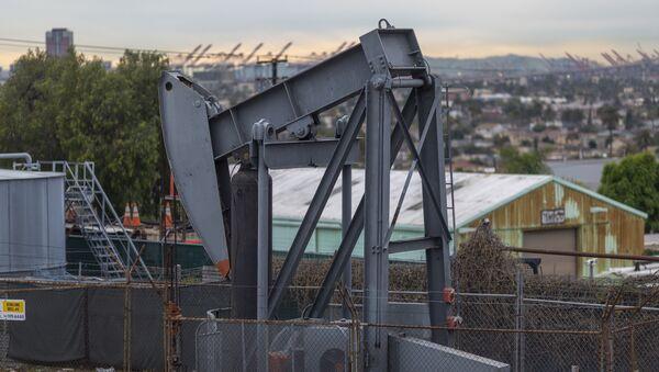 Pump jacks draw crude oil from the Long Beach Oil Field in Signal Hill, California, on March 9, 2020. - Sputnik International