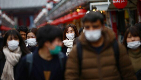 Tourists wearing protective face masks, following an outbreak of the coronavirus disease (COVID-19), visit Asakusa neighbourhood in Tokyo, Japan March 8, 2020 - Sputnik International
