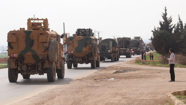 A Turkish military convoy drives near the Syrian town of Kefraya on the highway linking the northwestern Syrian province of Idlib to the Bab al-Hawa border crossing with Turkey, on March 10, 2020 - Sputnik International