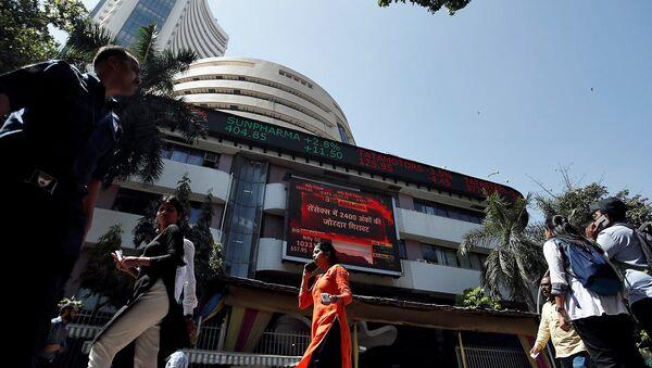 People walk past the Bombay Stock Exchange (BSE) building in Mumbai, India, March 9, 2020 - Sputnik International