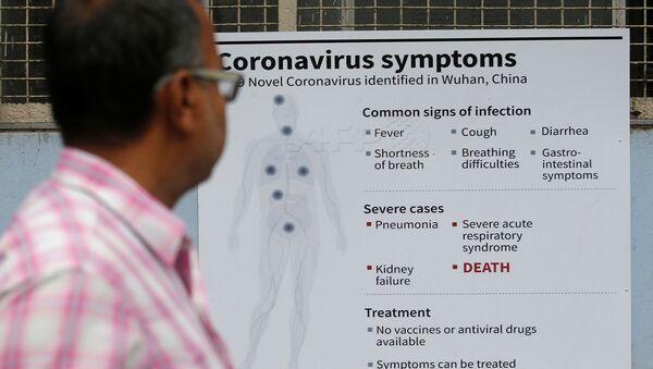 A man reads a poster carrying messages on symptoms of coronavirus disease inside hospital premises in Kolkata, India March 5, 2020.  - Sputnik International