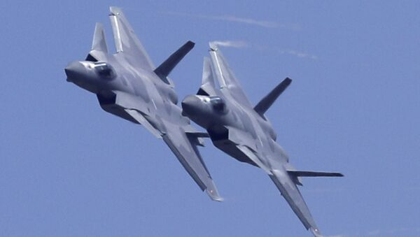 Two J-20 stealth fighter jets of the Chinese People's Liberation Army (PLA) Air Force performs during the 12th China International Aviation and Aerospace Exhibition, also known as Airshow China 2018, Tuesday, Nov. 6, 2018, in Zhuhai city, south China's Guangdong province - Sputnik International