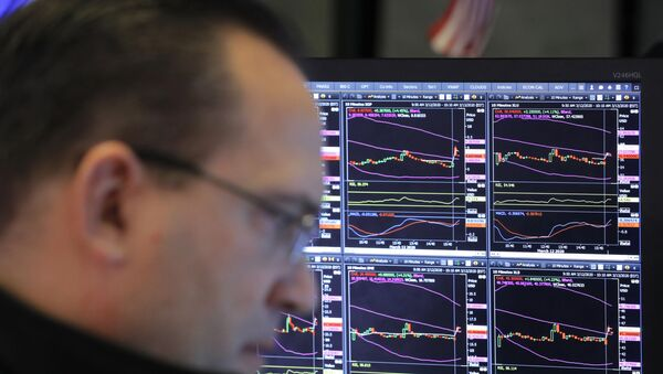 A trader works on the floor of the New York Stock Exchange (NYSE) after the opening bell of the trading session in New York, U.S., March 13, 2020 - Sputnik International