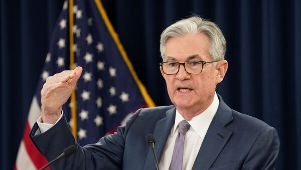 U.S. Federal Reserve Chairman Jerome Powell speaks to reporters after the Federal Reserve cut interest rates in an emergency move - Sputnik International