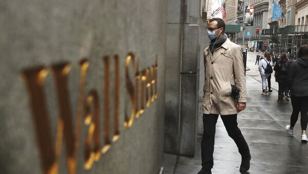 A man wears a protective mask as he walks on Wall Street during the coronavirus outbreak in New York City, New York, U.S., March 13, 2020 - Sputnik International