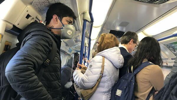 A man wears a mask on the London Underground amid the coronavirus outbreak - Sputnik International