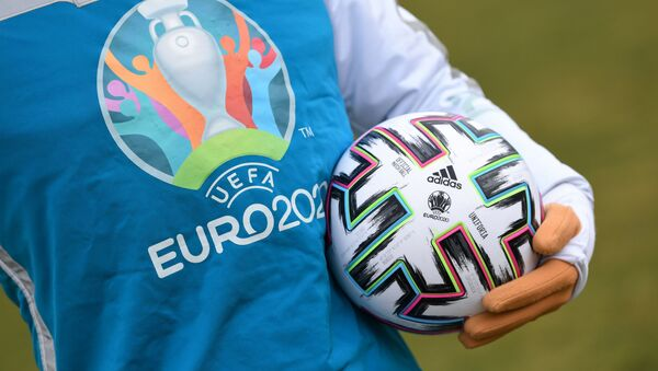 UEFA Euro 2020 mascot Skillzy poses for a photo with the official match ball at Olympiapark in Munich, Germany, March 3, 2020 - Sputnik International