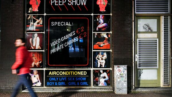 A sex club in Amsterdam's Red Light district closes its doors in response to a rapidly expanding coronavirus outbreak, in Amsterdam, Netherlands, March 15, 2020 - Sputnik International