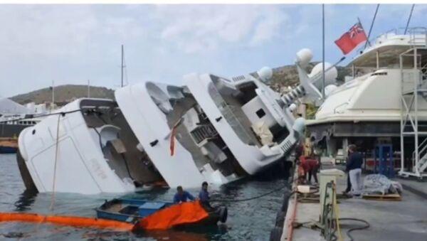 The $78 million luxury superyacht belonging to Saudi Prince Turki bin Mohamed bin Fahd Al Saud submerged underwater in Perama, Greece.  - Sputnik International