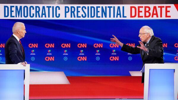 Democratic U.S. presidential candidate and former Vice President Joe Biden listens as Senator Bernie Sanders speaks during the 11th Democratic candidates debate of the 2020 U.S. presidential campaign - Sputnik International