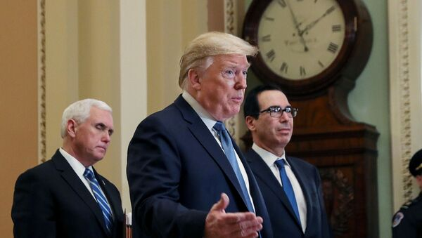U.S. President Donald Trump is flanked by Vice President Mike Pence and Treasury Secretary Steven Mnuchin as he speaks to members of the news media following a closed Senate Republican policy lunch meeting to discuss the response to the coronavirus outbreak with senators on Capitol Hill in Washington, U.S., March 10, 2020 - Sputnik International