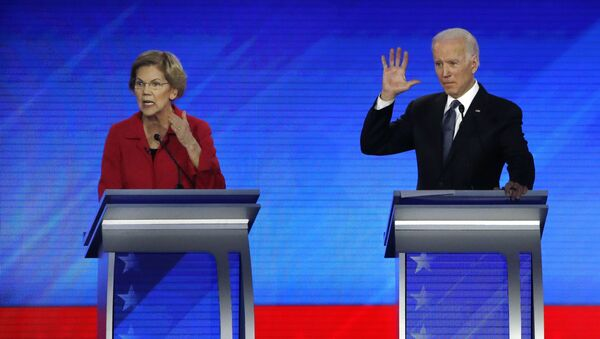 Democratic presidential candidate Sen. Elizabeth Warren, D-Mass., left, speaks as former Vice President Joe Biden waits during a Democratic presidential primary debate, Friday, Feb. 7, 2020, hosted by ABC News, Apple News, and WMUR-TV at Saint Anselm College in Manchester, N.H.  - Sputnik International