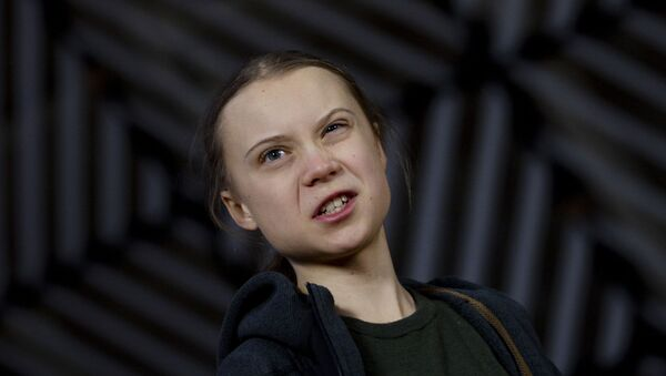 Swedish climate activist Greta Thunberg speaks with the media as she arrives for a meeting of the Environment Council at the European Council building in Brussels, 5 March 2020 - Sputnik International