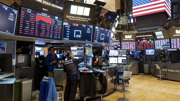 Traders work on the floor of the New York Stock Exchange near the end of the trading day, Monday, March 16, 2020 - Sputnik International