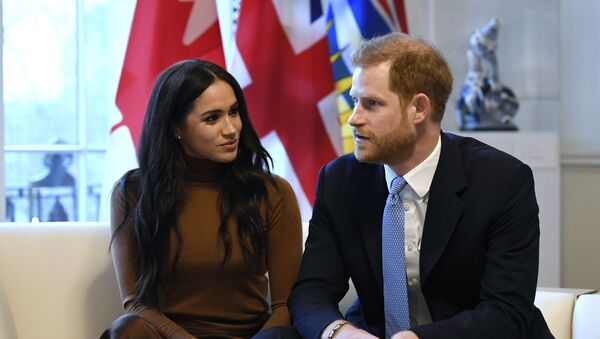 Britain's Prince Harry and Meghan, Duchess of Sussex gesture during their visit to Canada House in thanks for the warm Canadian hospitality and support they received during their recent stay in Canada, in London, Tuesday, Jan. 7, 2020 - Sputnik International