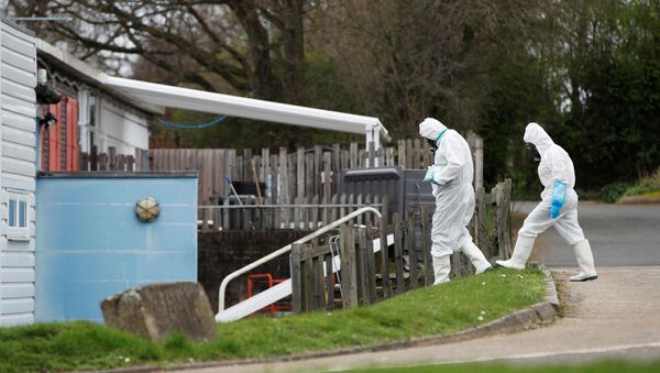 Staff from a cleaning company arrive at Parkside Community Primary School in Borehamwood as the spread of the coronavirus disease (COVID-19) continues, in Boreham Wood, Britain, March 18, 2020. - Sputnik International
