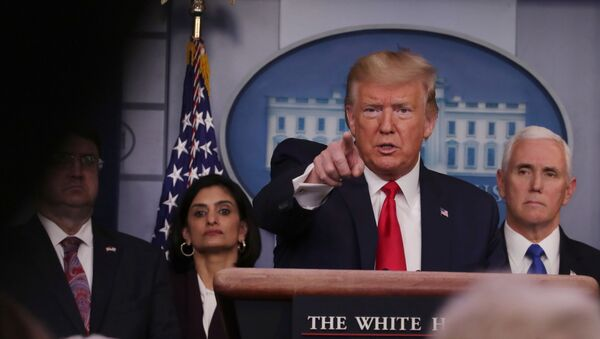 US President Donald Trump answers a question during the daily White House coronavirus response briefing with members of the administation's coronavirus task force at the White House in Washington, US, March 18, 2020 - Sputnik International