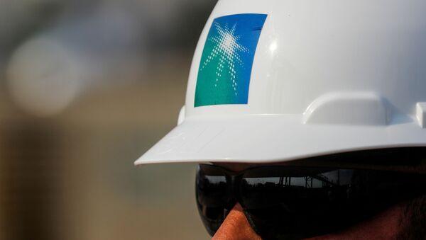 An employee in a branded helmet is pictured at Saudi Aramco oil facility in Abqaiq, Saudi Arabia October 12, 2019 - Sputnik International