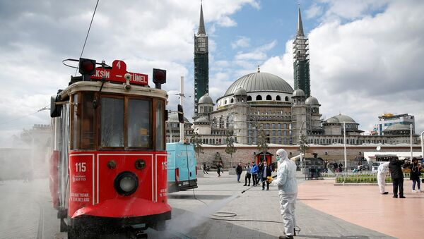A municipality worker sprays disinfectant over a tram to prevent the spread of coronavirus disease (COVID-19) in central Istanbul, Turkey, March 18, 2020 - Sputnik International