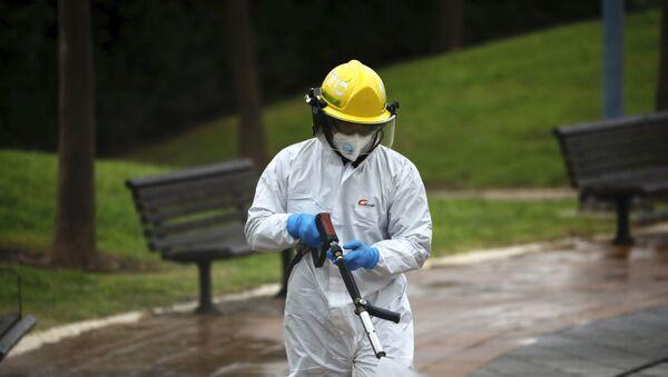 An Israeli firefighter sprays disinfectant in Modi'in, Israel - Sputnik International