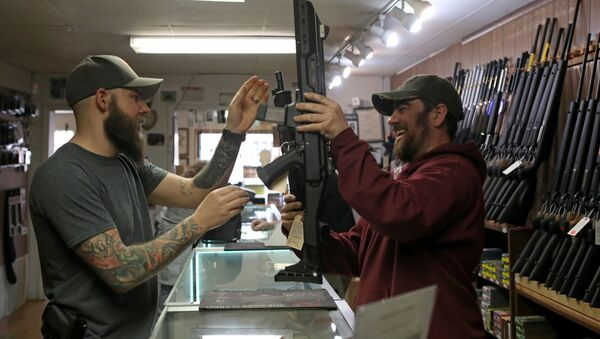 Customers handle semi-automatic rifles at Frontier Arms & Supply gun shop amid fears of the global growth of coronavirus disease (COVID-19) cases, in Cheyenne, Wyoming, U.S. March 18, 2020 - Sputnik International