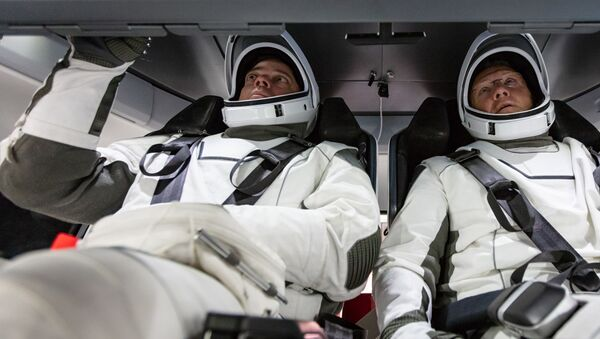 NASA astronauts Doug Hurley and Bob Behnken familiarise themselves with SpaceX's Crew Dragon, the spacecraft that will transport them to the International Space Station as part of NASA's Commercial Crew Program. Their upcoming flight test is known as Demo-2, short for Demonstration Mission 2. The Crew Dragon will launch on SpaceX's Falcon 9 rocket from Launch Complex 39A at NASA's Kennedy Space Center in Florida. - Sputnik International