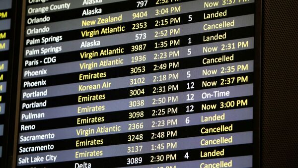 Several canceled flights are pictured on a monitor at Seattle-Tacoma International Airport as airlines are reeling from a plunge in bookings and traffic, as the fast-spreading coronavirus pandemic prompts travel restrictions and event cancellations around the world, in SeaTac, Washington, U.S. March 13, 2020 - Sputnik International