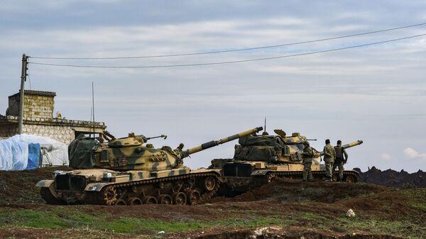 Turkish Army tanks stationed in the east of Idlib, Syria, Saturday, Feb. 15, 2020 - Sputnik International