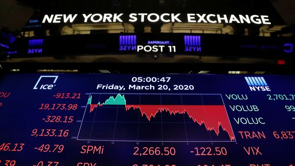 The final numbers of the day are displayed above the floor of the New York Stock Exchange (NYSE) stands empty as the building prepares to close indefinitely due to the coronavirus disease (COVID-19) outbreak in New York, U.S., March 20, 2020 - Sputnik International