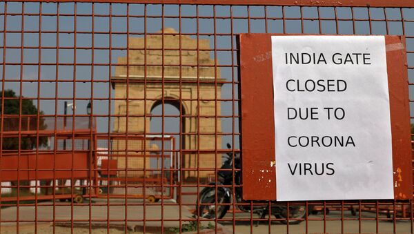 A sign pasted on a security barricade is seen after the India Gate war memorial was closed for visitors amid measures for coronavirus prevention in New Delhi, India, March 19, 2020.  - Sputnik International