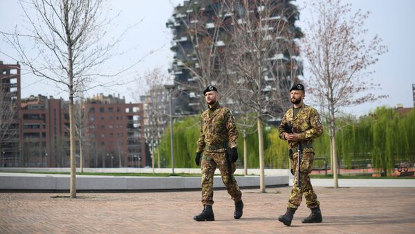 Italian army soldiers patrol streets after being deployed to the region of Lombardy to enforce the lockdown against the spread of coronavirus disease (COVID-19) in Milan, Italy, March 20, 2020 - Sputnik International