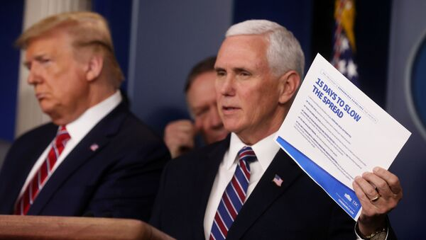 U.S. President Donald Trump and Secretary of State Mike Pompeo listen as Vice President Mike Pence addresses the Trump administration's daily coronavirus task force briefing while holding up a chart reading 15 Ways to Slow the Spread at the White House in Washington, U.S., March 20, 2020 - Sputnik International
