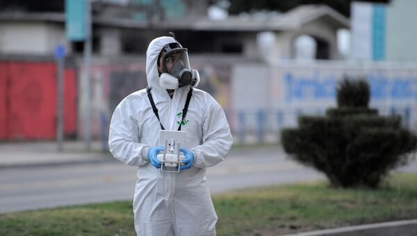 A local community worker uses a drone loaded with disinfectant to released on streets during the coronavirus disease (COVID-19) outbreak in Talcahuano, Chile March 21, 2020 - Sputnik International